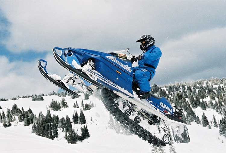 Snowmobile jump in mid-air during a 5 day ski trip