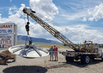 Couple standing in front of UFO from Area 51 Tour